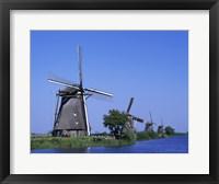 Framed Windmills along a river, Kinderdike, Amsterdam, Netherlands