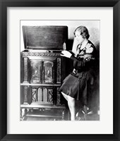 Framed Young woman sitting beside an RCA Radio-Phonograph and Home Recorder