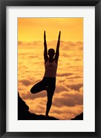 Framed Silhouette of a young woman practicing yoga, Maui, Hawaii