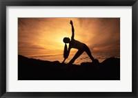 Framed Silhouette of a young woman practicing yoga, Haleakala, Maui, Hawaii, USA