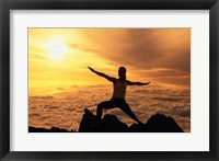 Framed Yellow silhouette of a young woman doing yoga, Hawaii, USA