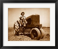Framed Farmer Plowing a Field with a Tractor