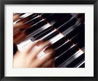 Framed Close-up of a person's hands playing a piano
