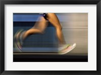 Framed Low section view of a person running on blue