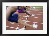 Framed Side profile of three people jumping a hurdle