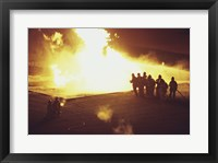 High angle view of firefighters extinguishing a fire Framed Print