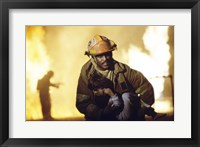 Framed Firefighter carrying a boy