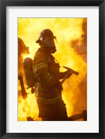 Framed Side profile of a firefighter (holding axe)