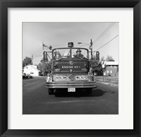 Fire engine on road Framed Print