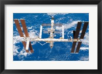 Framed International Space Station moves away from Space Shuttle Endeavour