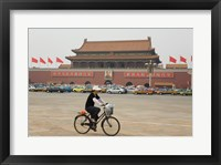 Framed Tourist riding a bicycle at a town square, Tiananmen Gate Of Heavenly Peace, Tiananmen Square, Beijing, China
