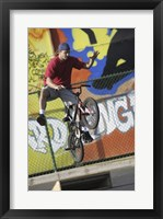 Teenage Boy Biking Framed Print