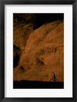 Silhouette of a man mountain biking, Utah, USA Framed Print