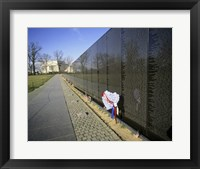 Close-up of a memorial, Vietnam Veterans Memorial Wall, Vietnam Veterans Memorial, Washington DC, USA Framed Print