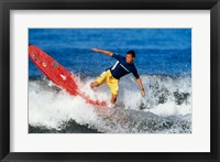 Surfing in the water Framed Print