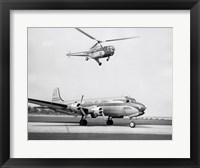 Framed Low angle view of a helicopter in flight and an airplane at an airport, Sikorsky Helicopter, Douglas DC-4