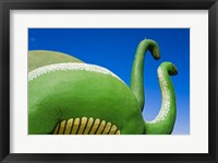 Sculptures of two dinosaurs outside a rock shop, Holbrook, Route 66, Arizona, USA Framed Print
