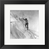 Washington - Mount Rainier Guide cutting steps on ice slope near summit Framed Print