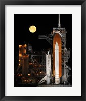 Framed Space Shuttle Discovery under a Full Moon
