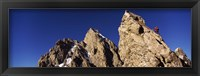 Framed Low angle view of a man climbing up a mountain, Rockchuck Peak, Grand Teton National Park, Wyoming, USA
