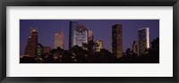 Framed Buildings in a city lit up at dusk, Houston, Harris county, Texas, USA