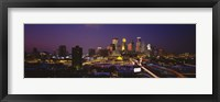 Framed Skyscrapers lit up at dusk, Minneapolis, Minnesota, USA