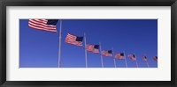 Framed Low angle view of American flags, Washington Monument, Washington DC, USA