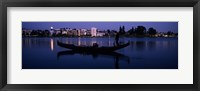 Framed Boat in a lake with city in the background, Lake Merritt, Oakland, Alameda County, California, USA