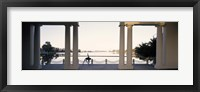 Framed Person stretching near colonnade, Lake Merritt, Oakland, Alameda County, California, USA