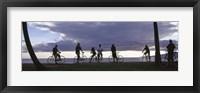 Framed Tourists cycling on the beach, Honolulu, Oahu, Hawaii, USA