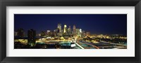 Framed Buildings lit up at night in a city, Minneapolis, Hennepin County, Minnesota, USA