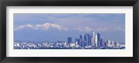 Framed Buildings in a city with snowcapped mountains in the background, San Gabriel Mountains, City of Los Angeles, California, USA