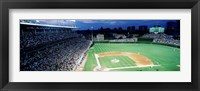 Framed Cubs baseball game under flood lights, USA, Illinois, Chicago