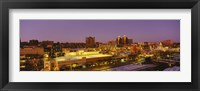 Framed High angle view of buildings lit up at dusk, Kansas City, Missouri, USA
