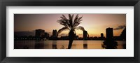 Framed Silhouette of buildings at the waterfront, Lake Eola, Summerlin Park, Orlando, Orange County, Florida, USA