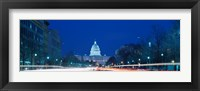 Framed Government building lit up at dusk, Capitol Building, Pennsylvania Avenue, Washington DC, USA