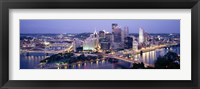 Framed Buildings in a city lit up at dusk, Pittsburgh, Allegheny County, Pennsylvania, USA