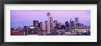 Framed Building lit up at dusk, Denver, Colorado, USA
