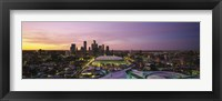 Framed Skyscrapers lit up at sunset, Minneapolis, Minnesota, USA