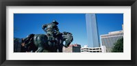 Framed Low Angle View Of A Statue In Front Of Buildings, Dallas, Texas, USA