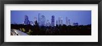 Framed Buildings lit up at dusk, Houston, Texas