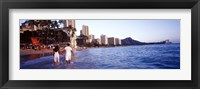 Framed Rear view of a couple wading on the beach, Waikiki Beach, Honolulu, Oahu, Hawaii, USA