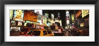 Framed Buildings lit up at night in a city, Broadway, Times Square, Midtown Manhattan, Manhattan, New York City, New York State, USA