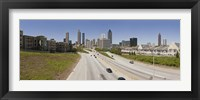 Framed Vehicles moving on the road leading towards the city, Atlanta, Georgia, USA