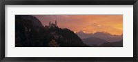 Framed Neuschwanstein Palace at dusk, Bavaria Germany