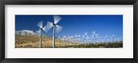 Framed Wind turbines spinning in a field, Palm Springs, California, USA
