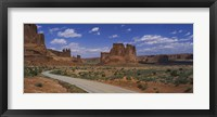 Framed Empty road running through a national park, Arches National Park, Utah, USA