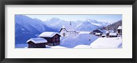 Framed Snow Covered Chapel and Chalets Swiss Alps Switzerland