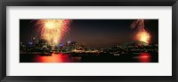 Framed Firework display at New year's eve in a city, Cremorne Point, Sydney, New South Wales, Australia