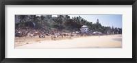 Framed Tourists on the beach, North Shore, Oahu, Hawaii, USA